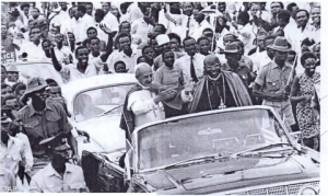 Pope Paul VI with the Late Cardinal Emmanuel Nsubuga in a convoy to Namugongo
